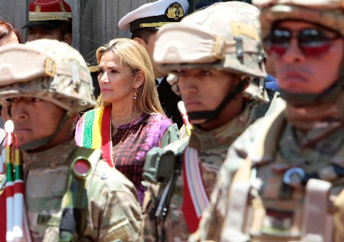 Bolivia's interim president cancels trip due to 'credible threat' as crisis roars on