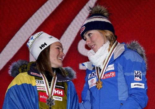 The Latest: Shiffrin calls Swedish fan up to stage