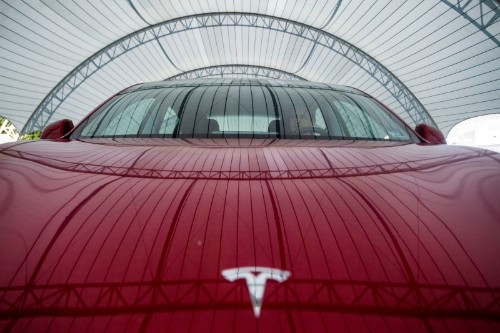 Tesla's furious rally pushes market value past $100 billion