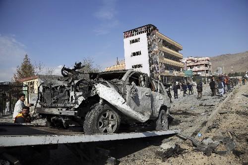 Afghan officials: Kabul car bomb killed 12, including kids