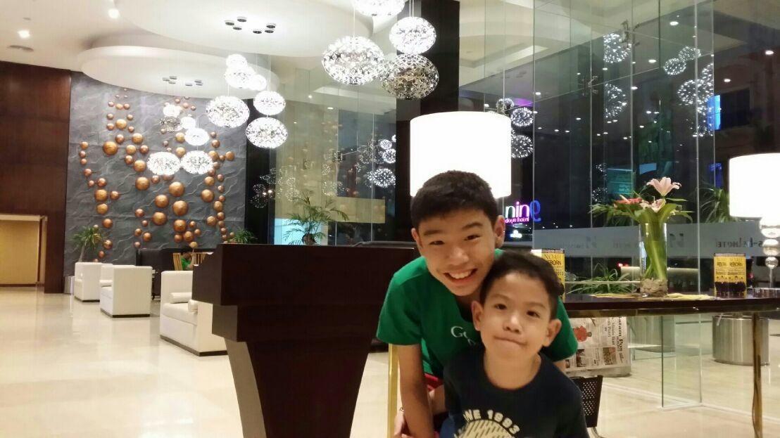 Siblings at the hotel lobby. Nice hotel!