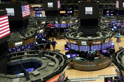 Stocks climb on oil price surge despite grim U.S. jobs data