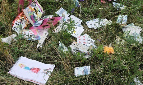 MH17 plane crash site: sunhats, sweets … and stakes marking body parts