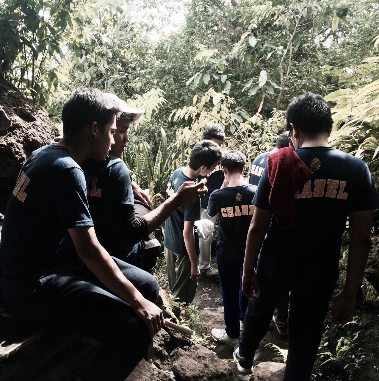 "(For English) ""Break-taking"" Several students from homeroom SPC take short breaks after having just painstakingly explored a deep cave system beneath the mountain. After the cave-exploration, the students take their Lunch break during the half time of their Outbound Trip last September 23, 2016. (Written by: Adrian Florin)"