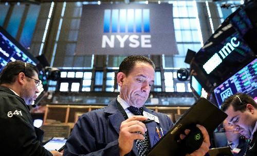Wall Street edges higher as tech offsets healthcare loss