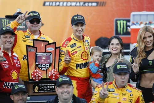 Logano outlasts field, weather to win at Michigan