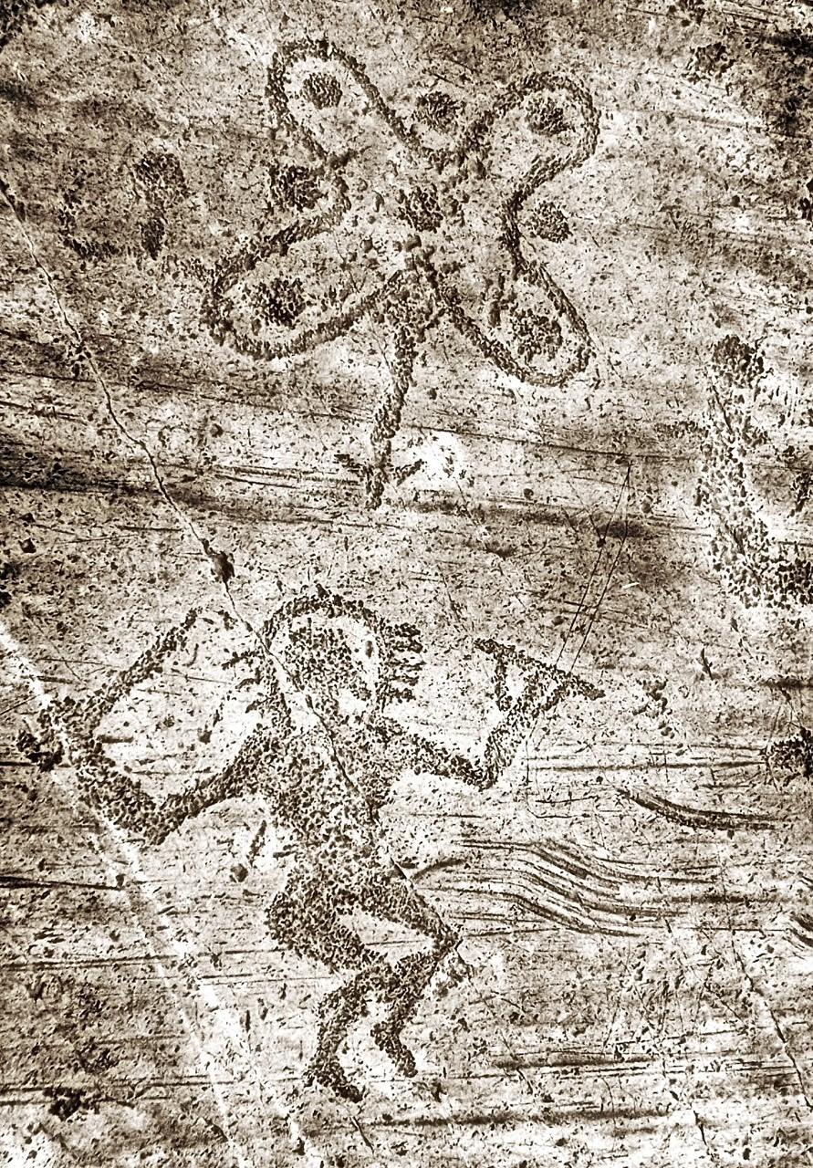 """Valcamonica - Brescia - """"Astronauta"""" preistorico . La """"rosa camuna"""", simbolo emblematico che ricorda il nodo di Salomone (simbolo di contatto tra l'uomo e gli dei ) é raffigurata come se fosse un oggetto volante sopra l'""""astronauta""""."""
