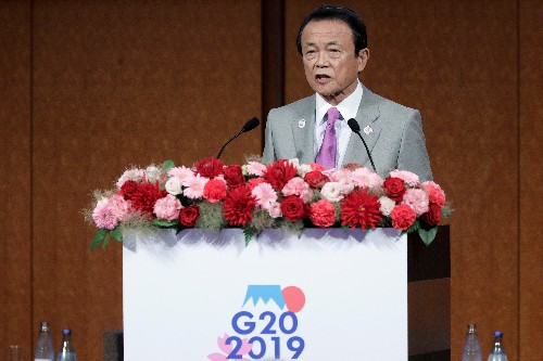 Japan finance minister Aso says he hopes markets will calm down