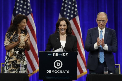 The Latest: Harris gets warm welcome at California meeting
