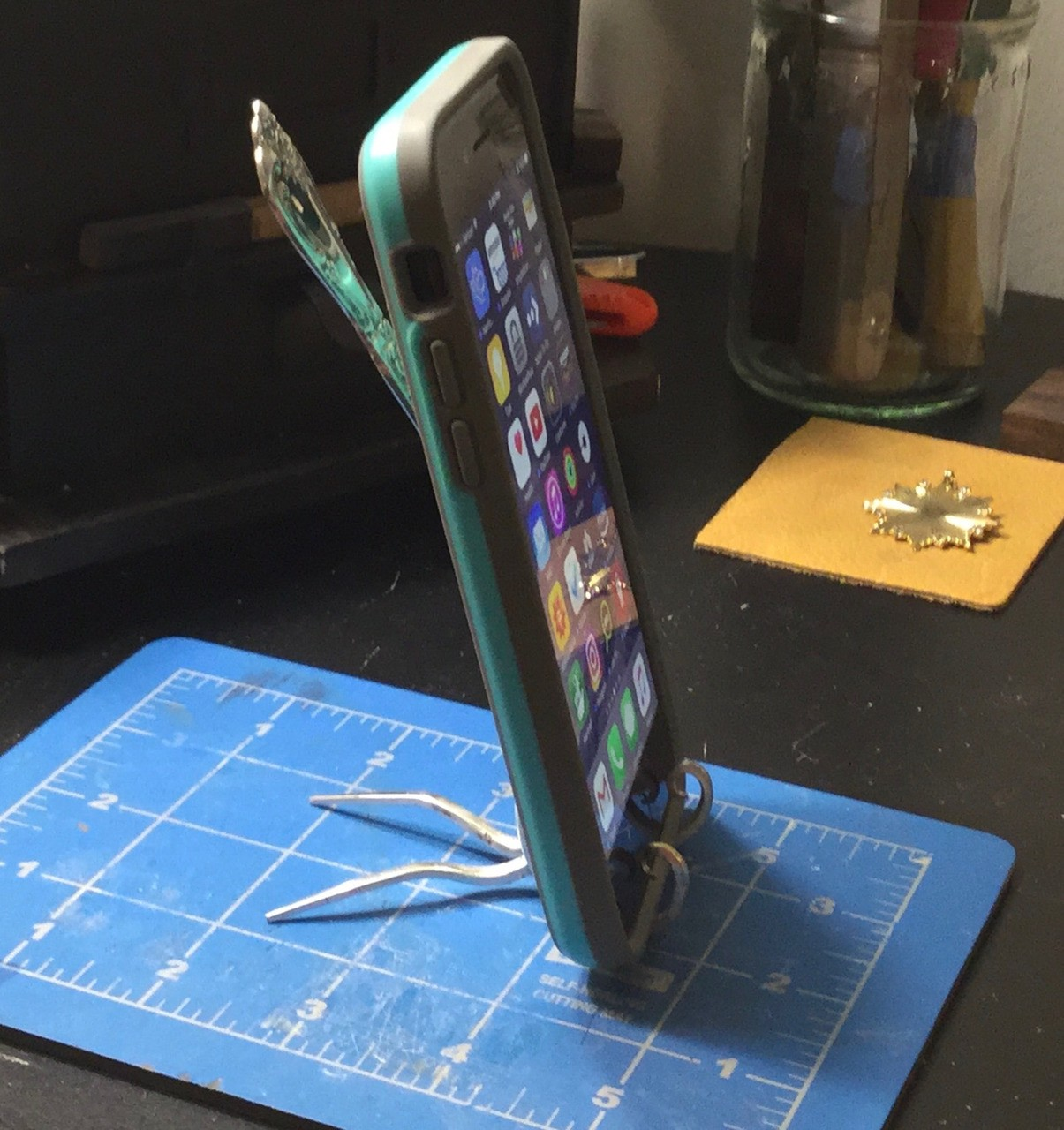 iPhone stand from an old fork. By NisBorjo