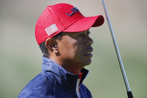 Golf: Tiger plans to make use of new flag rule