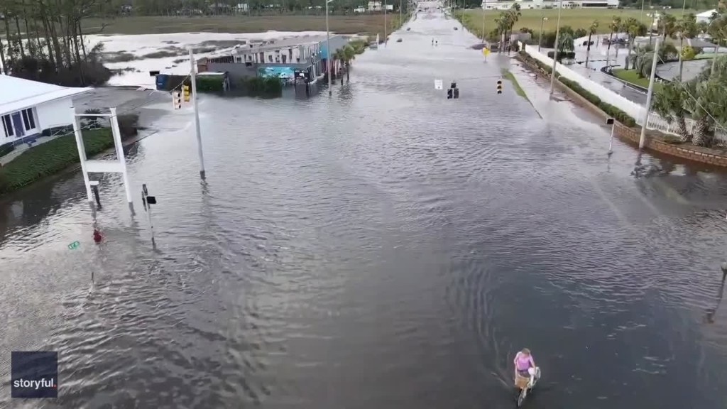 Kayakers Paddle Along in Flooded Gulf Shores Streets in the Aftermath of Hurricane Sally