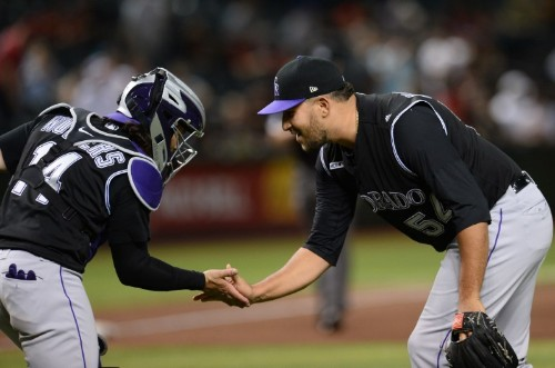 MLB roundup: Blackmon makes history in Rockies' rout