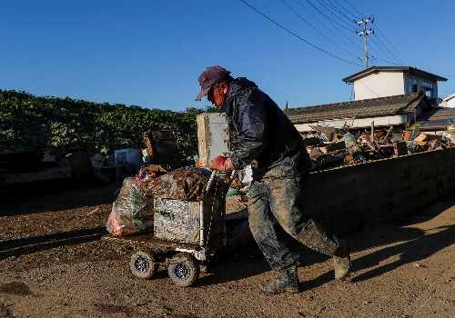 Japan ramps up spending for typhoon relief, but workers are scarce