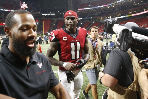 Jones scores late TD, leads Falcons past Eagles 24-20
