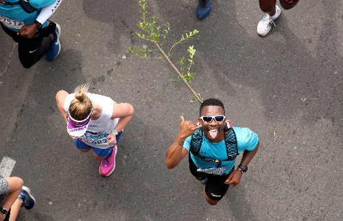 If marathons weren't hard enough already: strap a tree to your back