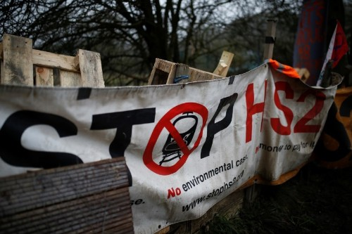 Protesters climb trees to protect UK woodland from planned rail link