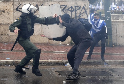 After violence, Greek parliament debates deal with Macedonia