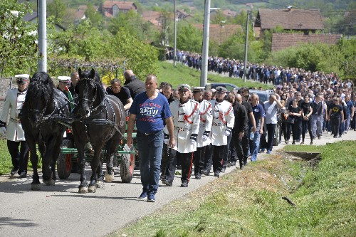 Thousands mourn Bosnian government critic slain in ambush