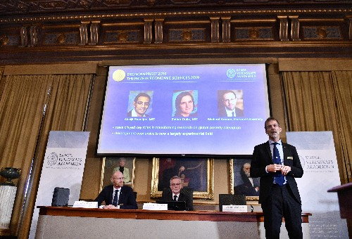 The Latest: Nobel winner thought message was scam at first