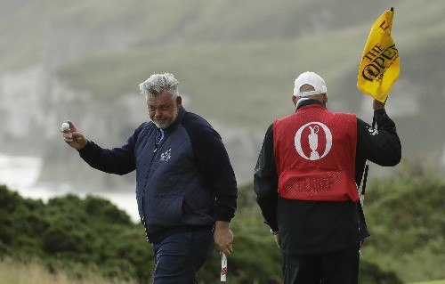 The Latest: McIlroy makes a late charge with 65
