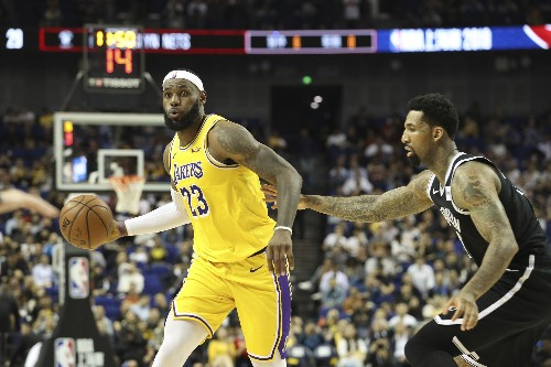 Irving aggravates injury, Nets hold off Lakers in Shanghai