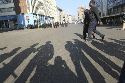 The Latest: Zimbabwe court upholds police ban on protest