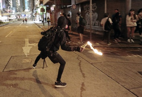 Tear gas engulfs Hong Kong as protesters trash China agency