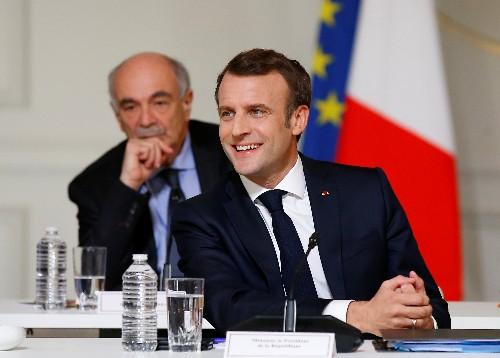 After Paris violence, pressure mounts on Macron's post-debate response