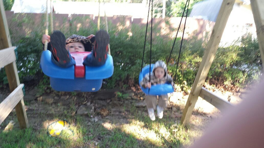 Alana and ayden swinging on their new swing set