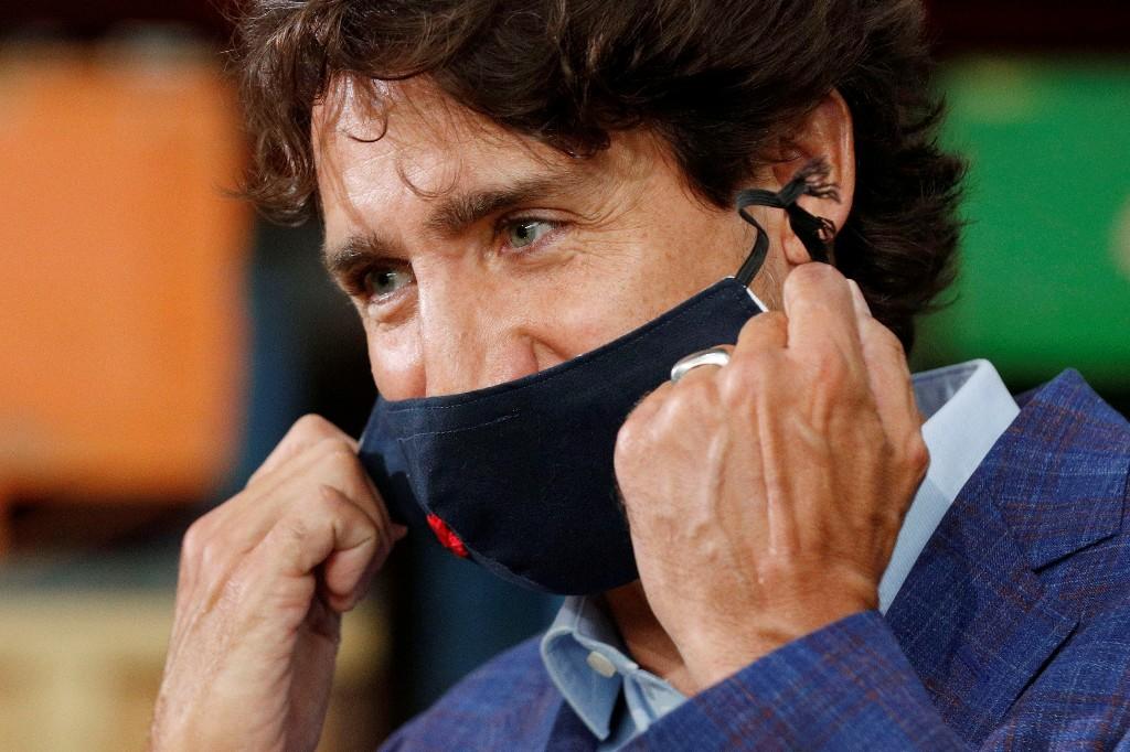 Canada's Trudeau predicts 'tough winter,' deaths top 10,000