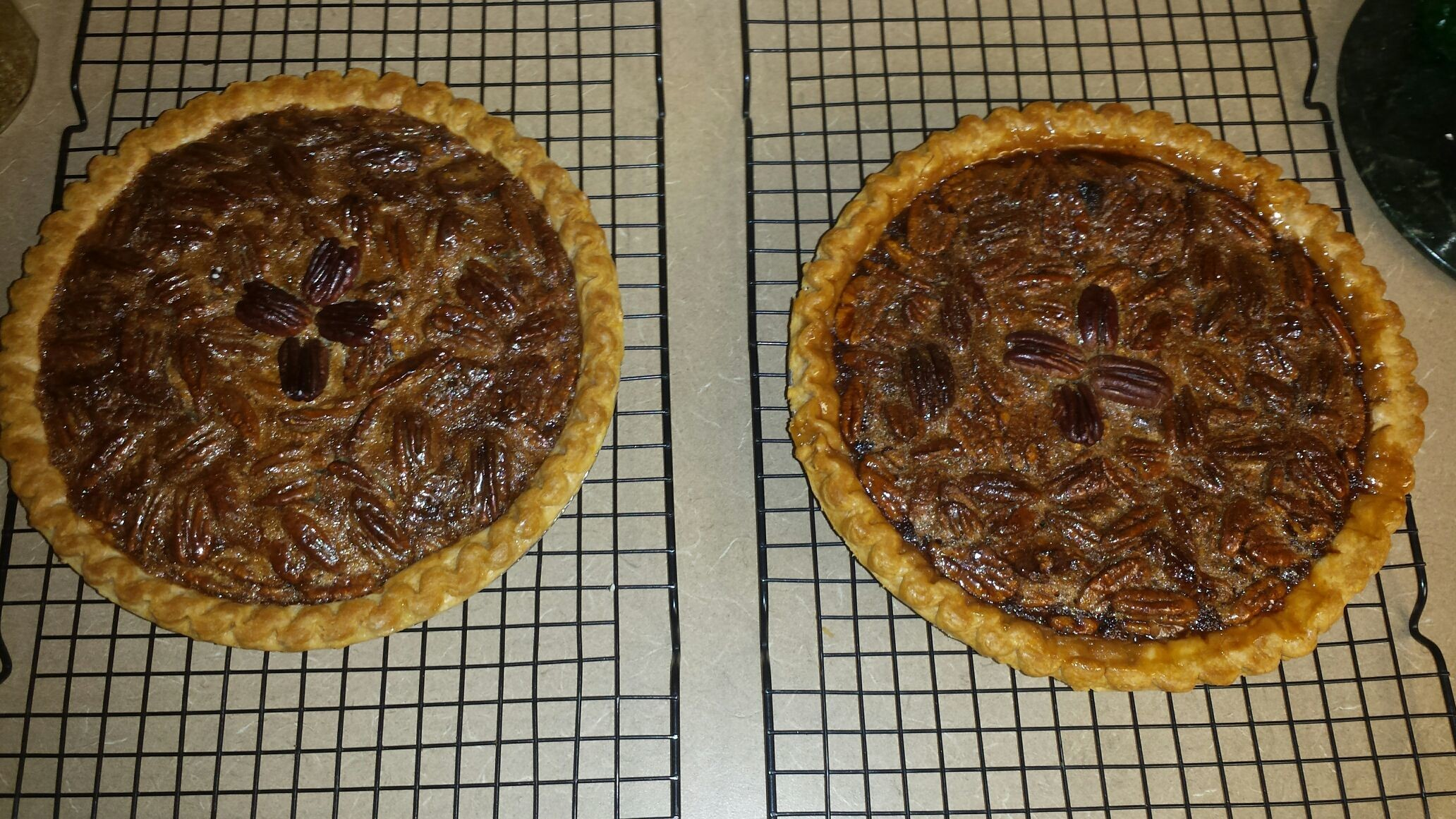 """First two pecan pies of the Thanksgiving holiday. Maddison has an English class party this Friday. She wanted me to make one pie for the class and one for her teacher. Jonathan is drooling. I also made """"acorn kisses"""". I'll try to put a picture up of that. They turned out ok.. not like THEY pictured. They are really really tasty though"""