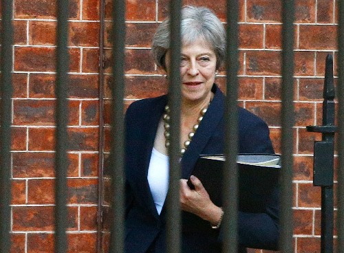 UK's May tries to calm Brexit rebels, says deal almost done