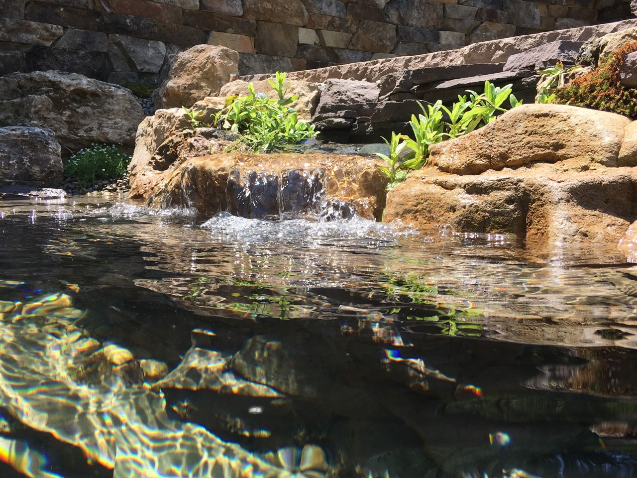 Formal/artistic style pond and waterfall built by Aquatic Edge.