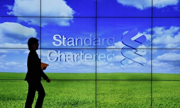 Standard Chartered credit rating downgraded for first time in 20 years