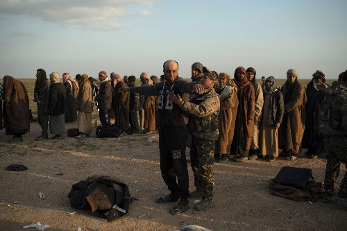 Told to leave, IS 'caliphate' holdouts in Syria stay devoted