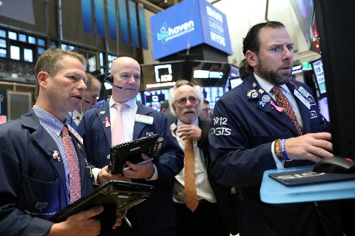 Wall Street jumps as Powell hints interest rate hikes may taper off