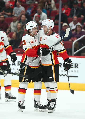 Flames top Coyotes, remain unbeaten under Ward