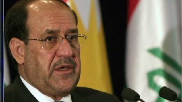 Iraqi troops and tanks surge into Baghdad amid political turmoil