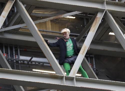 Climate protester in Boris Johnson garb scales Big Ben tower