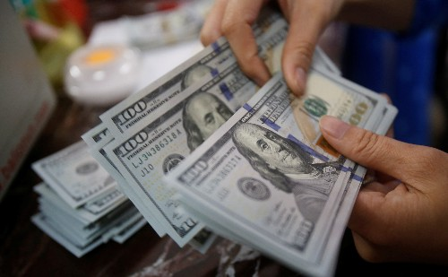 Dollar retreats from two-year high overnight, set for weekly loss