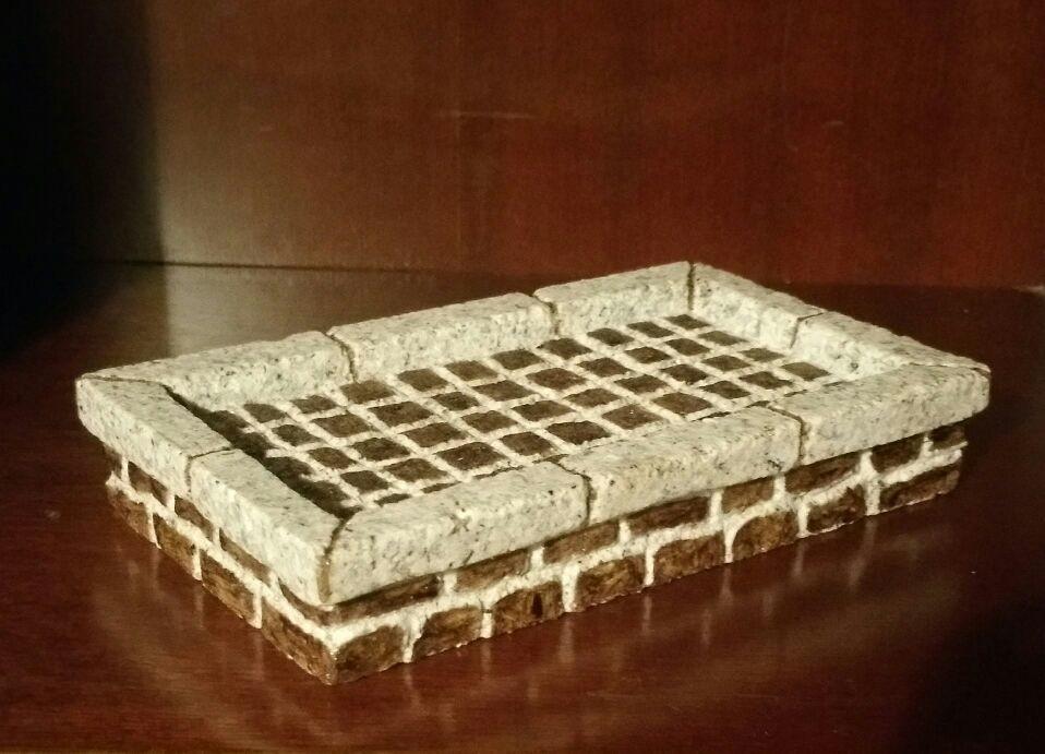 Pieza en granito tallada y decorada a mano de 17x3x10 cm.