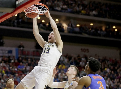 NCAA Latest: Florida-Michigan matches grade-school teammates