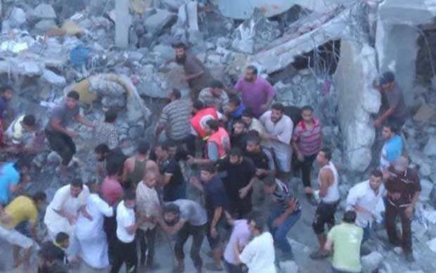 Israel air strikes on Gaza: Palestinian rescue workers scramble for cover from missiles