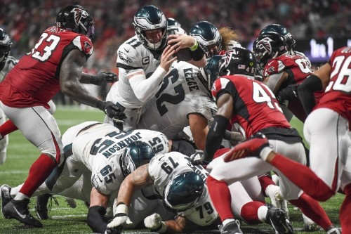 Falcons score late, hang on to defeat Eagles