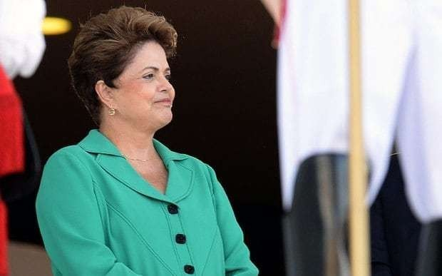 Rousseff on course to beat surprise challenger as Brazilians go to the polls