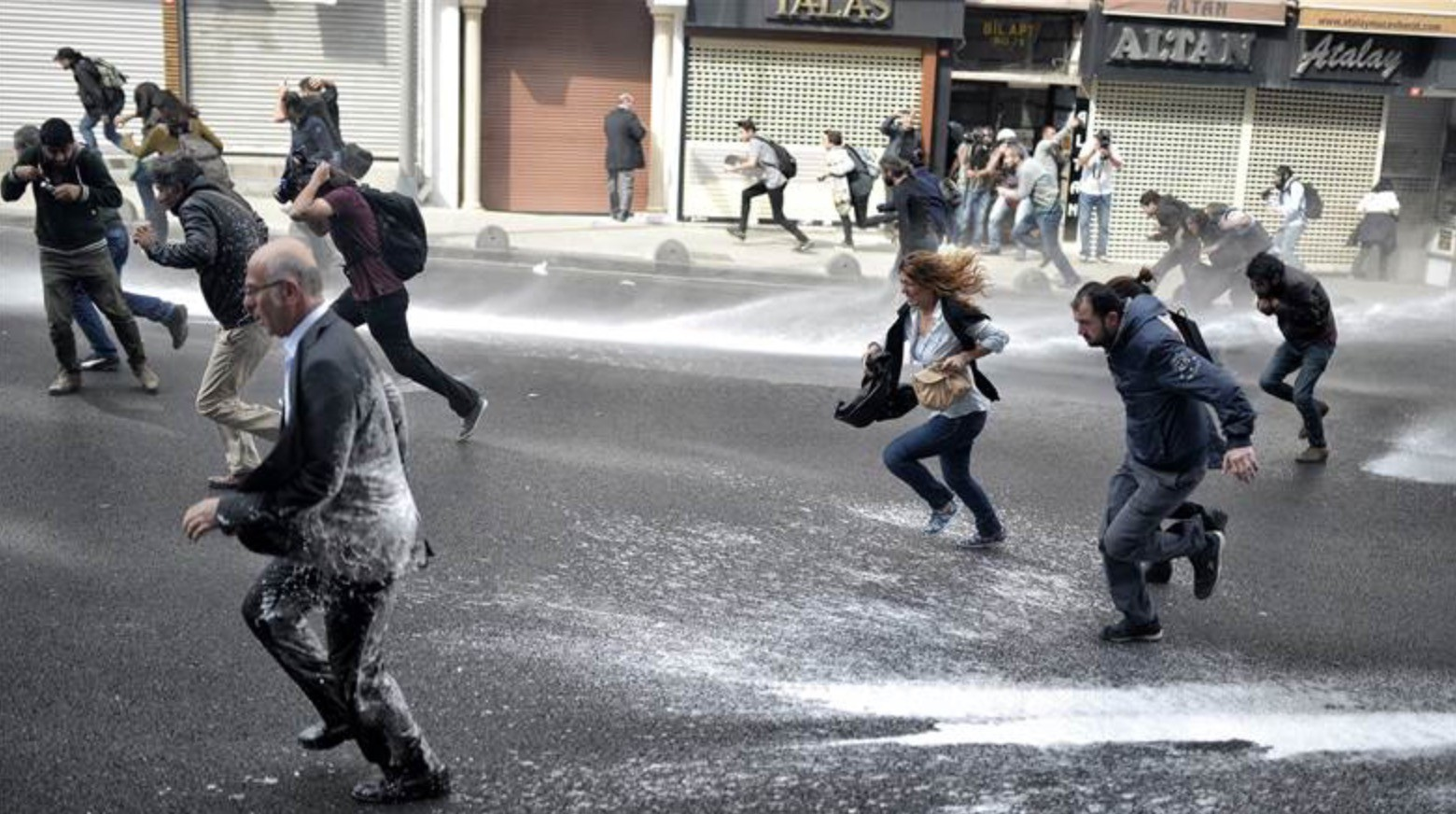 Turkish police use a water cannon to disperse demonstrators protesting Islamic State militants in Istanbul, Turkey, on Oct. 7. Airstrikes hit three groups of Islamic State fighters on the southern outskirts of the besieged Kurdish town of Kobani, the Syrian Observatory for Human Rights said