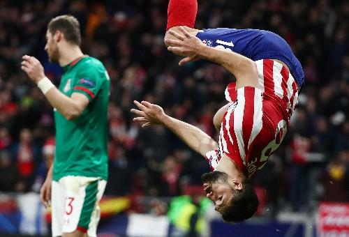 Atletico stroll into Champions League knockouts