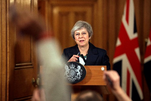 'I'm going to see this through': UK PM May vows to fight for Brexit deal