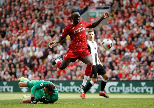 Soccer: City suffer shock defeat, Liverpool five points clear